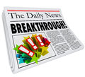 Breakthrough newspaper headline big announcement discovery word on a to announce a or solution to a problem Royalty Free Stock Image
