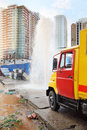 Breakthrough sewerage systems fountain emergency service truck Royalty Free Stock Photo