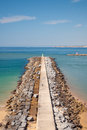 Breakwater in algarve beach portugal sunny summer day Stock Images