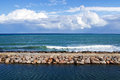 Breakwater and clouds Royalty Free Stock Photo