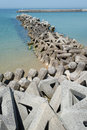 Breakwater with concrete blocks for protection of coast Stock Images