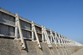 Breakwater seawall against a blue sky Royalty Free Stock Images