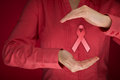 Breast cancer awareness woman with protective and support gesture and pink ribbon Royalty Free Stock Photography