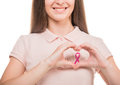 Breast cancer close up of smiling young woman in blank t shirt with pink awareness ribbon Royalty Free Stock Photos
