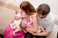Breast feeding twin babies at home two sisters suck the mother s Stock Photography
