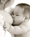 Breastfeeding baby mother and close up asian mother boy in sepia tone Stock Photography