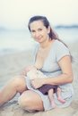 Breastfeeding mother a baby outdoor Royalty Free Stock Photo
