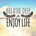 Breathe deep enjoy life a landscape with text overlay Royalty Free Stock Image