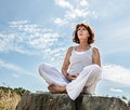 Breathing outdoors for beautiful middle aged yoga woman Royalty Free Stock Photo
