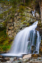 Breathtaking Waterfall in Mountains Royalty Free Stock Photo