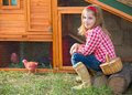 Breeder hens kid girl rancher farmer with chicks in chicken coop blond playing tractor Stock Images