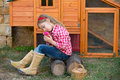 Breeder hens kid girl rancher farmer with chicks in chicken coop blond playing tractor Stock Photography