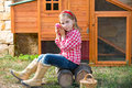 Breeder hens kid girl rancher farmer with chicks in chicken coop blond playing tractor Stock Photo