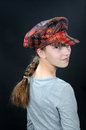 Breezy teenager girl with colorful hat Royalty Free Stock Images