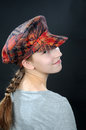 Breezy teenager girl with colorful hat Royalty Free Stock Photography