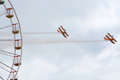 Breitling wing walkers at blackpool air show aerobatics team giving a daring walking flying past the wheel the Stock Images