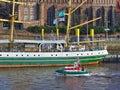 Bremen, Germany - November 23rd, 2017 - Lifeboat Flinthörn passing the sailing ship Alexander von Humboldt Royalty Free Stock Photo