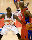 Brevin knight guards chauncey billups of the charlotte bobcats during a game against the detroit pistons at the the palace of Royalty Free Stock Images