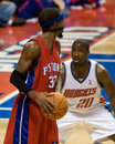 Brevin knight guards richard hamilton of the charlotte bobcats during a game against the detroit pistons at the the palace of Royalty Free Stock Photo