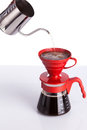 Brew coffee in pour over on white background Royalty Free Stock Photo