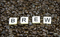 Brew game pieces set in coffee beans Stock Photos