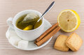 Brewed tea, sugar and cinnamon, lemon and shortbread cookies Royalty Free Stock Photo