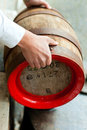 Brewer with beer barrel in brewery Royalty Free Stock Photos