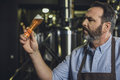 Brewery worker with glass of beer Royalty Free Stock Photo