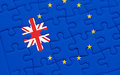 Brexit blue european union EU flag puzzle with puzzle piece with great britain flag Royalty Free Stock Photo
