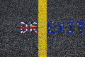 Brexit blue european union EU flag and uk great britain united kingdom flag, over tarmac, road marking yellow paint separating lin