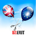 Brexit concept. Scissors cutting EU and UK balloons Royalty Free Stock Photo