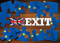 Brexit - Word breaking puzzle flag of the European Union on wooden background Royalty Free Stock Photo