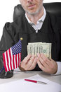 Bribery corrupt american judge taking money as a bribe or stealing Royalty Free Stock Photo