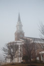 Brick baptist church early morning dense fog Stock Photos