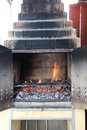 Brick barbecue with flames ready to be used Royalty Free Stock Photo