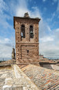 Brick bell tower of the church of san antolin de tordesillas located in spain its style is mudejar bells are in a picture Stock Image