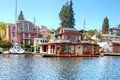 Brick boat house lake washington beatiful with glass door walkout deck and attached dock Royalty Free Stock Photos