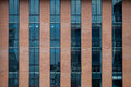 Brick Building Facade with a Blue Glass for Texture. Royalty Free Stock Photo