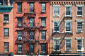 Brick buildings with outside fire escape stairs usa new york Stock Photography