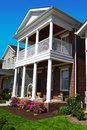Brick Cape Cod Style Home with Porch Stock Image