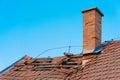 Brick chimney on old abandoned roof Royalty Free Stock Photo