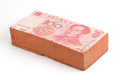 Brick with a Chinese Yuan Royalty Free Stock Photos