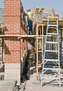 Brick Columns with Scaffolding Stock Image