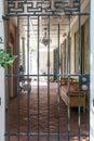 Brick Courtyard Beyond Black Iron Gate