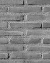Brick encased wall background in black and white Stock Photo