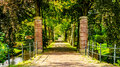 Brick Gate posts and tree lined lane into an Estate in the historic village of Midden Beemster Royalty Free Stock Photo