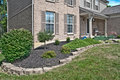 Brick Home Landscaping Beds Royalty Free Stock Photo