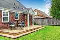 Brick house exterior with walkout wooden deck patio area Royalty Free Stock Photography