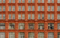 Brick house red with identical windows Royalty Free Stock Photos