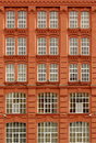 Brick house red with identical windows Royalty Free Stock Photo